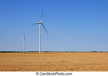 wind turbines on wheat field green energy