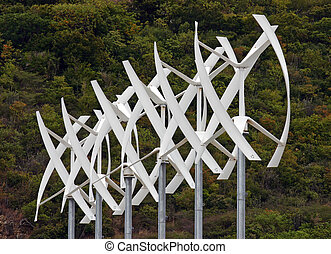 Wind Turbines - A group of modern white wind turbines