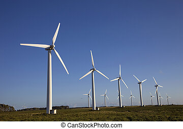 wind turbines - white wind turbines in the top of the...