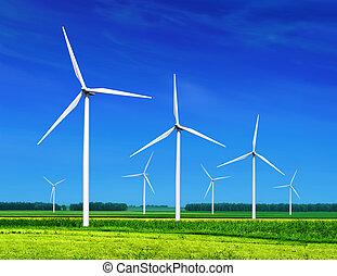 Wind turbines - green meadow with Wind turbines generating...