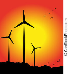 Wind turbines silhouette in the sunset