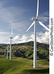 Wind farm on top of green hills