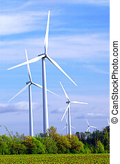 Wind turbines - Wind power generators in the field against...