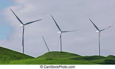 Wind turbines with blue sky on farm field