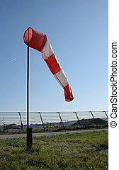 Wind vane at the airport and blue background - Wind vane at...