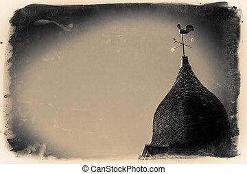 Wind Vane - A golden wind vane above a church in the...