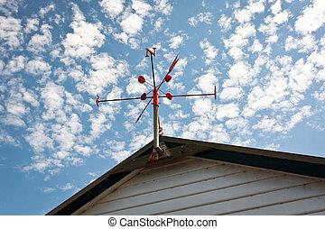 wind vane - red wind vane at the roof top