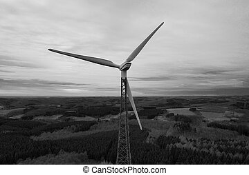 wind wheel over a winter landscape in black and white