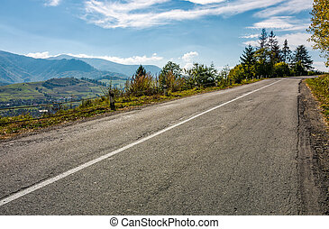 countryside road through mountains - winding countryside...
