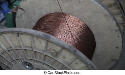 Winding of a wire on a bobbin - Winding of metal wire on a...