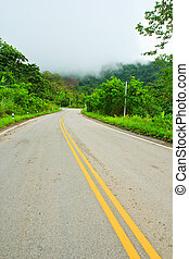 Winding Paved Road in the Phetchabun Province  asai Thailand