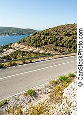 winding road in deserted landscape in vis island