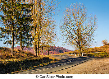 winding road in late autumn mountains. lovely transportation...