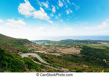 Winding road on a green hill in Sardinia