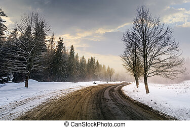 winding road through forest in winter. beautiful nature...