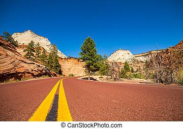 Road through mountainous area near Zion NP, Utah, USA