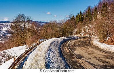 winding serpentine in winter mountains - winding serpentine...
