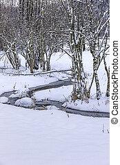 Winding small creek in winter.