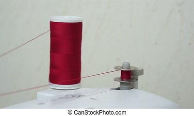 Winding Up a Sewing Bobbin Thread - Close up shot of a...
