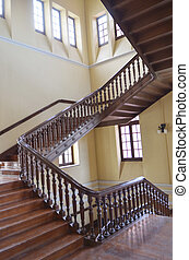 Winding wood staircase in building