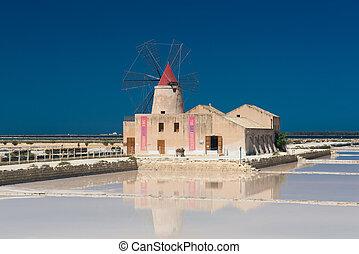Windmill and salt pans at the salina of Trapani