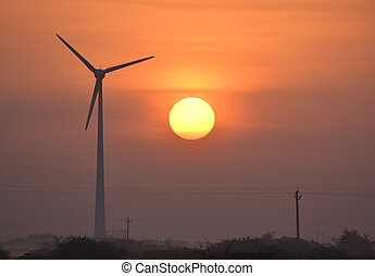 Windmill energy and the morning sunrise in city Dwarka