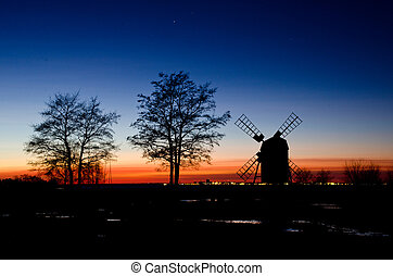 Windmill and trees in sunset