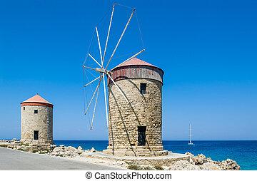 Windmill at Rhodes - Old windmill at Rhodes island marina...