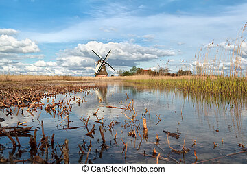 windmill, blue sky and river