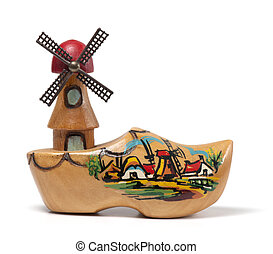 A wooden clog windmill souvenir from the Netherlands. With shadow on a white background.