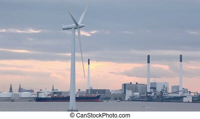 Windmill for electric energy generation in sea near factory