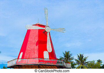 Windmill house on blue sky background