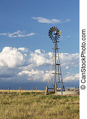 windmill in Colorado prairie - windmill with a pump and ...