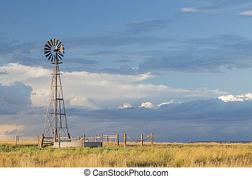 windmill in Colorado prairie - windmill with a pump and...