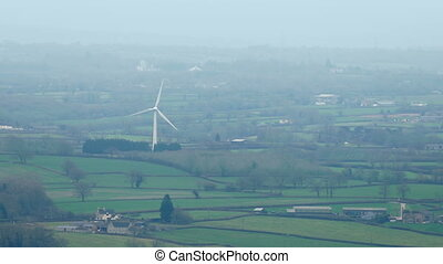 Windmill In Misty Rural Landscape - Renewable energy...