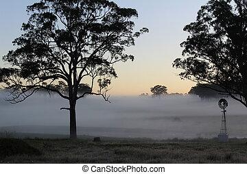 Windmill in morning mist