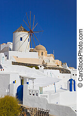 Windmill in Oia at Santorini island, Greece