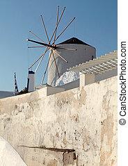 Windmill in Oia Village, Santorini, Greece.