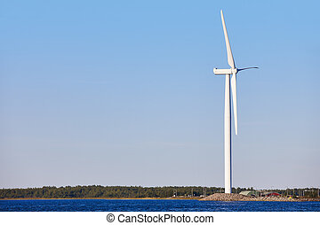 Windmill in the baltic sea. Renewable clean and green energy