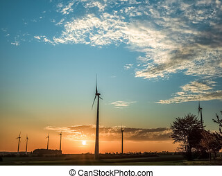 windmill in the field, windmill with solar plants, renewable resources for the environment