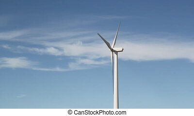 Windmill. - Modern wind turbine against blue sky with...