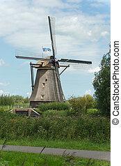 Windmill near Kinderdijk in NL (UN world heritage) - A...