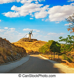 Windmill of Don Quixote and road in Consuegra. Castile La Mancha