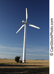 Windmill on a field in northern Germany.