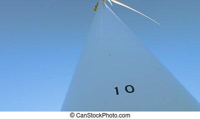 Windmill on blue sky background