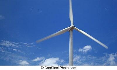 Windmill on blue sky