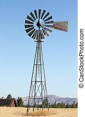 Windmill on Farmland - Windmill on Wheat Grass Farmland in...