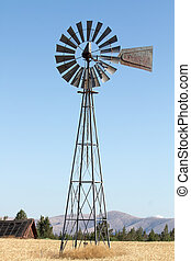 Windmill on Farmland - Windmill on Wheat Grass Farmland in...