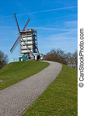 Windmill on hill with path