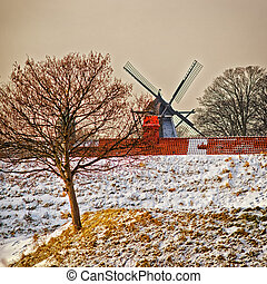 Windmill on the hill in winter